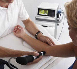 Shockwave therapy being applied to elbow injury.